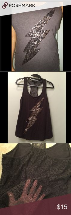 Express Lightening Bolt Sequined Tank This charcoal colored tank is in good condition, normal wear but no flaws. This is a racerback tank and the back is made of see thru lace (see photo). Have questions, please ask! ✨ Bundle from my closet to save!! ✌🏼️ Express Tops Tank Tops