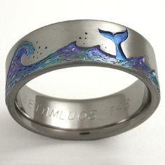 Titanium band with waves and whale tail motif. Ring shown: 8mm wide, size 11.5
