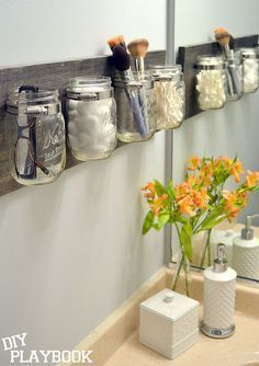 20 Bathroom Organization Ideas via a Blissful Nest, DIY Mason Jar Organization by DIY Playbook Pot Mason Diy, Mason Jar Crafts, Pots Mason, Mason Jar Shelf, Diy Mason Jar Lights, Hanging Mason Jars, Mason Jar Lighting, Mason Har, Mason Jar Planter
