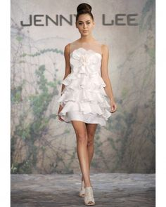 Short and Flirty  The high hemline and girlish ruffles on this Jenny Lee  shift would make it a great reception or cake-cutting option. c2ac553b0