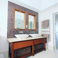 Finished luxury bathroom blending warm walnut timber with chic stone countertop and porcelain basins for this vanity unit. by nathankingsbury http://discoverdmci.com