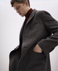 An elegant vision, Mathias Lauridsen wears a Massimo Dutti wool herringbone coat with a turtleneck sweater.