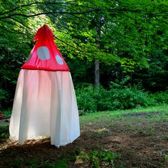 Toadstool tent.. Dollar store table clothes, hula hoop and tape!