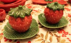 Strawberry condiment jars with underplates