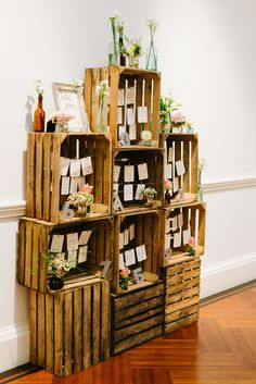 Apple crate feature-style table plan with vintage bottles and rustic English county flowers