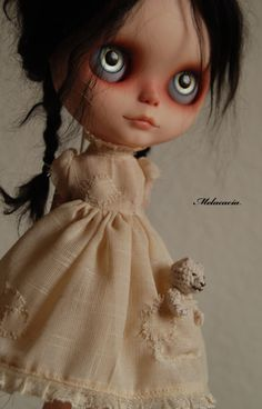 Blythe Doll {disheveled braid against white dress} - these things are so creepy that I actually kind of want one.
