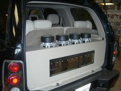 Cadillac Escalade 2004 custom subwoofer enclosure with 4 JL Audio 8W7