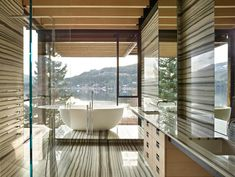 A family ski retreat as designed to withstand a harsh mountain environment by Olson Kundig Architects in Whistler, British Columbia, Canada. Whistler, Marble Interior, Home Interior, Interior Design, Kelly Wearstler, Steel Windows, Windows And Doors, Steel Doors, Foyers