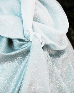 A shot of Cinderella's redesigned costume at the parks. I like how the photo editing/lighting makes it look closer to the original silvery-blue tint it had in the original movie.