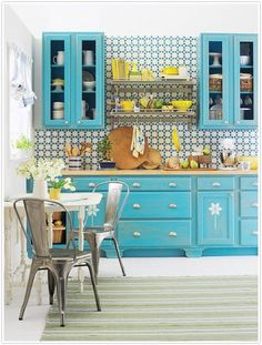 Love the bright colored cabinets and the interesting tile.
