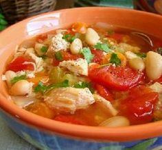 Slow-Cooker Chicken & Bean Soup: All hail the slow cooker: It makes it a breeze to prepare healthy-yet-hearty meals for the busiest of weeknights! Use store-bought rotisserie chicken to make this crowd-pleasing soup even easier.