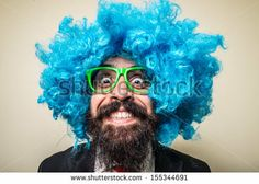 crazy funny bearded man with blue wig on white background by Eugenio Marongiu, via ShutterStock from $1