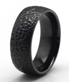 This pure Titanium mens ring has a unique meteorite design. The top of the band has a melted surface look along with high polish round edges for a comfortable