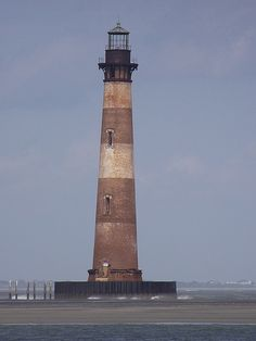 Morris Island Lighthouse, Folly Beach, South Carolina this is the light house I use to play near as a child now you cannot walk up to it cause the water has come in so much from hurricaines Folly Beach South Carolina, Folly Beach Pier, Morris Island, Lighthouse Pictures, Light Of The World, Windmill, Vacation Spots, Strand, Places To See