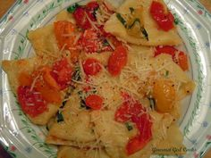 Grilled Chicken & Mozzarella Ravioli that I tossed in a simple mixture of fresh Cherub cherry tomatoes, Campari tomatoes, yellow tomatoes and orange tomatoes