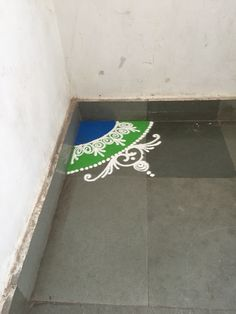 Random Rangoli in the corner of the office building.   #Rangoli, also known as Kolam or Muggu, is a folk art from #India in which patterns are created on the floor in living rooms or courtyards using materials such as colored rice, dry flour, colored sand or flower petals. ~#Wikipedia.   #IncredibleIndia #Pune #KoregaonPark #Travel #TravelAddict