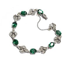 1940s Art Deco Sterling Silver Emerald by RubyInTheDustVintage #rubyinthedust #rubyinthedustvintage #vintagejewelry #glamour #weddingjewelry #bridaljewelry #somethingold #antiquejewelry #estatejewelry #weddings #bracelet #oldhollywood #sterlingsilver #sterling #1940s #vintagesilver #artdeco #rhinestone #emeralds