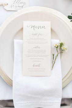 all white place setting with menu