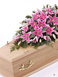 Lily Casket Spray - Pink 4ft. A blanket of pink Oriental Lily is beautifully complemented by an array of luxurious deep green leaves to create this simple but striking casket spray. Approximate height 122cm (4ft).
