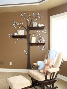 love the tree painted on the wall with shelves attached looking like branches which hold baby stuff! How adorable for a baby nursery