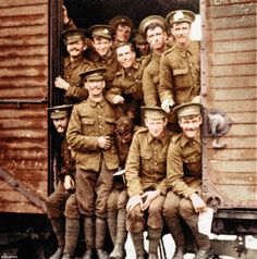 Horsebox to hell: British troops pose in a railway carriage  en route to the front in 1916. A sign on the sliding door on the right proclaims 'Hommes' and 'Chevaux': the men often had to share their transport with horses