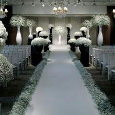 Gorgeous wedding aisle coveted in baby's breath by Jeff Leatham.