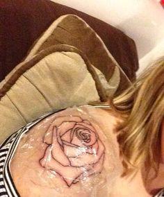 rose outline on ball of shoulder