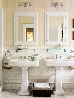 Side-by-side pedestal sinks by Kohler and Walker Zanger subway tiles give this new bath period-perfect style.