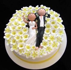 Awwww! Bride and groom in a field of plumeria. By Clare's Cakes via Cake Wrecks Sunday Sweets