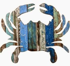 Coastal Decor with a Summer vibe. Wood art creatures handmade in the USA.