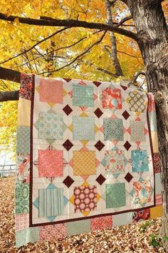 "nice use of the big pieces you hate to cut into! pattern is called ""Square Dance"" from the ""Livin' Large"" by Heather Peterson of Anka's Treasures, a book of patterns designed to reature large pieces. Another shot here http://sewmod.wordpress.com/2011/07/25/a-weekend-full-of-friends-fun-and-quilting-part-1/ shows the sashing more clearly.:"
