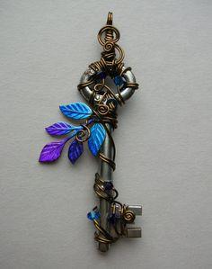 Blue-Purple Fairy Tree Wire Wrapped Key Pendant -- inked leaf sprig, vintage bronze wire, Swarovski crystals. $56.00, via Etsy.