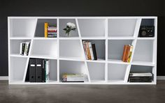 A2 ANGLE SHELF  Growing tired of your solemnly square Expidit shelving? Add some attitude back to your home or office with the A2 Angle Shelf ($1,750). Made from white MDF, the Angle measures in at over six feet wide, and offers a total of 18 differently-shaped and -proportioned cubbies in which to proudly display your books, toys, and other trinkets.