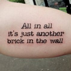 """""""All in all it's just another brick in the wall"""" quote tattoo"""