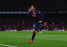 Luis Suarez of Barcelona celebrates as he scores their second goal during the La Liga match between FC Barcelona and Real Madrid CF at Camp Nou on March 22, 2015 in Barcelona, Catalonia.