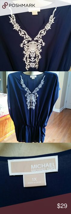 Michael kors embroidered blouse Navy and white. Drawstring. Beautiful embroidery around neck. Drop sleeve. Comfy. Gently loved. MICHAEL Michael Kors Tops Blouses