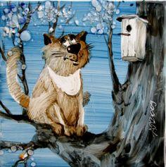 Chat à la mine craquante guettant devant un nichoir à oiseaux, sur un arbre. -  Anatoly Yaryshkin