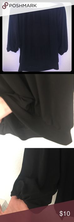 Express black flowy off shoulder blouse The perfect solid black blouse for your wardrobe! Flowy and meant to be worn off the shoulder, but top of neckline also has thin elastic lining so it can be worn regularly too for more coverage. Bottom and sleeves have elastic. Only imperfection is slight twisting of lining at neckline. Size small but could easily fit a medium! Loose fit Express Tops Blouses