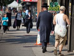 Hasidic Jews believe in covering themselves up when in public, even on sweltering days. But they are not complaining: It is an article of faith.