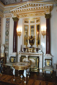 Pavlovsk Palace -The Boudoir of the Empress. The Boudoir's elegant fireplace with a niche decorated with mirrors is set in a portico with two monolithic porphyry columns brought from Rome. The classical portico with a pediment is the compositional centre of the interior.