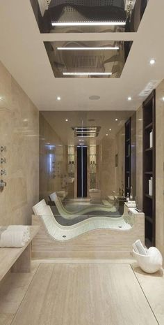 I love the borderless shower floor with the rain fall shower heads build into the ceiling. The bathtub also looks cool.
