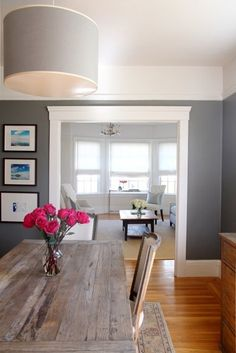 This grey dining room is simple and elegant, could be dressed up or down per the occasion. the living room and foyer are both a light grey so this would blend well! same colored hardwood floors too :)