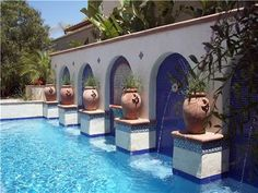 I love the rich blue color of the tiles and how they contrast with the terra cotta planters. This idea could be used in a small garden by incorporating similar pots and some simple tile details. Design by Studio H Landscape Architecture in Newport Beach, CA. Read more about this landscape at http://www.landscapingnetwork.com/backyard-ideas/design-ideas/small-space-mediterranean.html