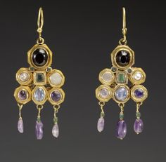 ca. 600 (Early Medieval). Gold, pearls, and semiprecious stones. These dramatic, colorful earrings were most likely made in Constantinople, perhaps as an imperial gift to a Visigothic ruler of medieval Spain, where the earrings were found. The Visigoths, a migratory group that ultimately settled in Spain, had by the 6th century established trade and diplomatic contacts with the Byzantine court, whose jewelry they much admired.