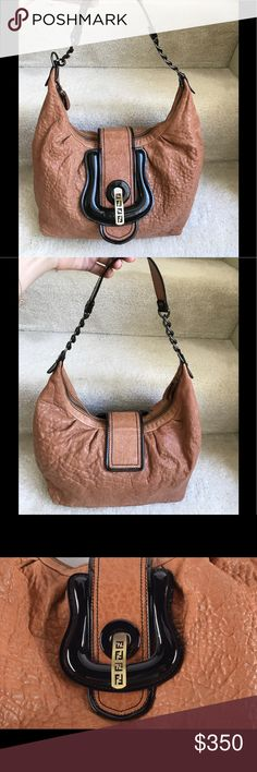 """FENDI B 💯% brown leather hobo shoulder bag 100% authentic. Mahogany textured pebble leather. Looping chain strap w/leather pad, belt closure and buckle details, aged gold tone hardware FENDI logo. Top zipper closure opens to dark brown fabric interior with one small pocket next to a big pocket. EUC, Pre-loved with minor wear on base corners and faint marks on interior fabric (not obvious). Ask me for more photos if you're serious.   Measurements: height 10"""",  width 11-16"""",  depth 5"""",  strap…"""