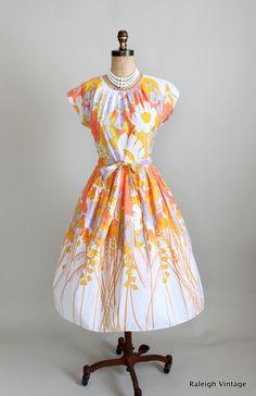 1960s Swirl wrap dress.    https://www.etsy.com/listing/106030291/vintage-1960s-dress-60s-swirl-wrap-dress