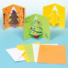 Buy Christmas Tree Pop-out Cards at Baker Ross. A 'tree'-ific Christmas card! Pre-cut and folded card blanks with a pop-out Christmas tree in the centre. Decorate with gl Pop Up Christmas Cards, Christmas Tree Cards, Christmas Makes, Christmas Design, Christmas Themes, Kids Christmas, Christmas Crafts, Craft Activities For Kids, Crafts For Kids