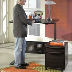 Sit and Stand Height Adjustable Desk - Espresso by The Ergo Office. $1948.99. When 3:30 rolls around on a workday and you're feeling stiff, don't worry - you aren't aging more quickly than you think you are. You're really just feeling the effects of sitting in one place a little too long - pressure on the discs in your back is increased 40 percent by sitting rather standing. That's why the Sit and Stand Height Adjustable Desk - Espresso is designed to work for your ...