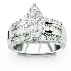 A marquise surrounded by baguettes and round brilliant diamonds...oh my! aprildrivera
