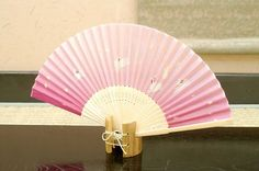 Authentic Japanese Hand Fan - Happy Rabbits #1!$15.00  The Japanese hand fans are an important symbol in Japan . They were used by warriors as a form of weapon, actors and dancers for performances, and children as a toy. In Japan fans are given to others as present and serve as trays for holding gifts. You would also find them sometimes used in religious ceremonies and events.